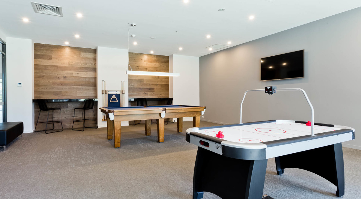 Games room with pool table and air hockey table
